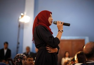 A Libyan student asks U.S. Secretary of State Hillary Clinton a question during a town hall meeting with the Youth and Civil Society at Tripoli University in Libya