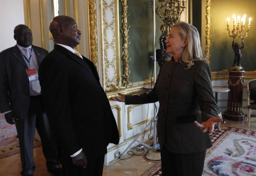U.S. Secretary of State Hillary Clinton meets Uganda's President Yoweri Museveni at the London Conference on Somalia