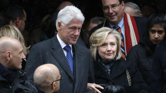 Former U.S. president Bill Clinton and his wife, former U.S. Secretary of State Hillary Clinton, depart after the funeral service for former New York Governor Cuomo in New York