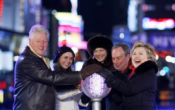 Former US President Clinton and his wife Hillary push the button to lower the crystal ball at midnight in Times Square during New Year festivities in New York