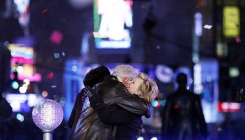 Bill and Hillary Clinton embrace at midnight in Times Square after pushing the button to lower the crystal ball during New Year festivities in New York