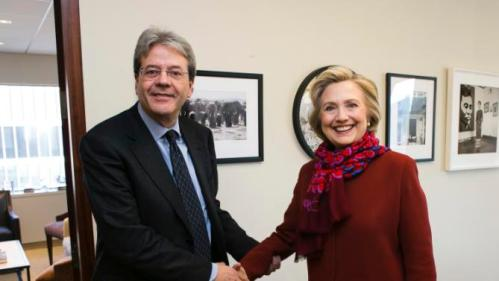 Italian Foreign Minister Paolo Gentiloni shakes hands with former Secretary of State Hillary Clinton at the Clinton Foundation in New York