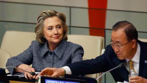 Former U.S. Secretary of State Hillary Clinton sits next to United Nations Secretary General Ban Ki-Moon during the Annual Women's Empowerment event at the United Nations in New York