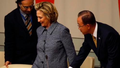 Former U.S. Secretary of State Hillary Clinton is helped to her seat by United Nations Secretary General Ban Ki-Moon during the Annual Women's Empowerment event at the United Nations in New York