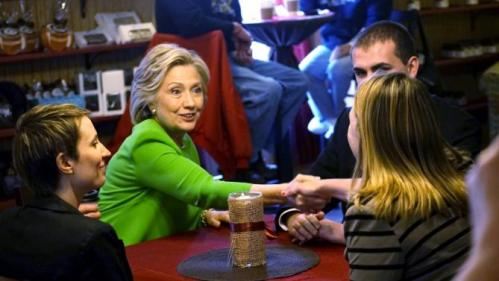 Former U.S. Secretary of State Clinton talks with local residents as she campaigns at the Jones Street Java House in LeClaire, Iowa