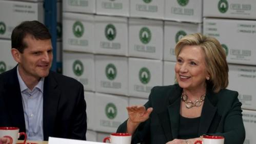 U.S. presidential candidate and former Secretary of State Hillary Clinton talks to small business owners, including Brendan Comito COO of Capital City Fruit as she campaigns for the 2016 Democratic presidential nomination at Capital City Fruit in Norfolk