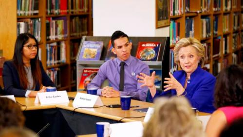 Former U.S. Secretary of State Hillary Clinton takes part in a roundtable of young Nevadans discussing immigration as she campaigns for the 2016 Democratic presidential nomination at Rancho High School in Las Vegas