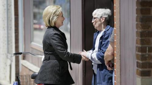 Democratic presidential candidate Hillary Rodham Clinton greets a local resident while visiting local shops on main street in Independence, Iowa, Tuesday, May 19, 2015. (AP Photo/Charlie Neibergall)