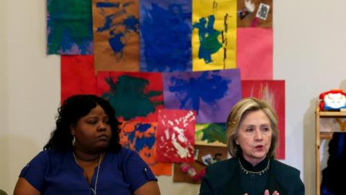 U.S. presidential candidate Hillary Clinton speaks at a roundtable discussion about childcare next to Lakesia Collins during a campaign stop in Chicago, Illinois, United States, May 20, 2015.    REUTERS/Jim Young