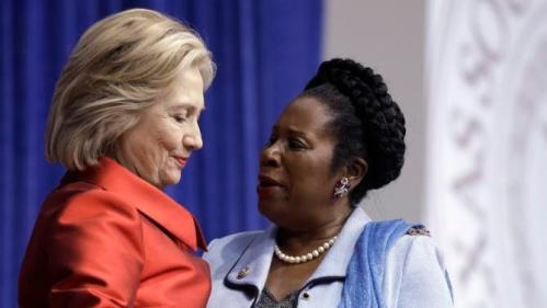 Democratic presidential candidate Hillary Rodham Clinton, left, talks with U.S. Rep. Sheila Jackson Lee, Thursday, June 4, 2015, at Texas Southern University in Houston. Clinton is calling for an expansion of early voting and pushing back against Republican-led efforts to restrict voting access, laying down a marker on voting rights at the start of her presidential campaign. (AP Photo/Pat Sullivan)