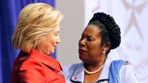 Democratic presidential candidate Hillary Clinton (L) greets Congresswoman Sheila Jackson Lee prior to receiving the Barbara Jordan Public-Private Leadership Award at Texas Southern University in Houston, Texas June 4, 2015. REUTERS/Donna Carson