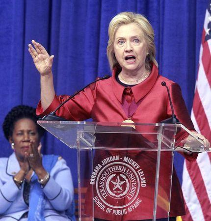 Democratic presidential candidate Hillary Clinton speaks after receiving the Barbara Jordan Public-Private Leadership Award  during an appearance at Texas Southern University in Houston June 4, 2015. U.S. Rep Sheila Jackson Lee applauds at left.  REUTERS/Donna Carson