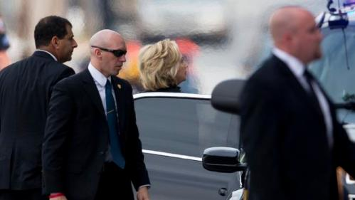 Democratic presidential candidate, former Secretary of State Hillary Rodham Clinton arrives before a funeral for former Delaware Attorney General Beau Biden, Saturday, June 6, 2015, at St. Anthony of Padua Roman Catholic Church in Wilmington, Del. Biden, the eldest son of the vice president, died of brain cancer May 30 at age 46.  (AP Photo/Matt Rourke)