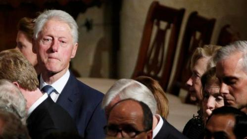 Former U.S. President Bill Clinton (L) and Democratic presidential candidate Hillary Clinton (R) watch as the casket of former Delaware Attorney General Beau Biden, son of Vice President Biden, is taken from his funeral at St. Anthony of Padua church in Wilimington, Delaware June 6, 2015.  REUTERS/Kevin Lamarque