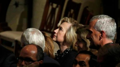 U.S. Democratic presidential candidate Hillary Clinton (C) and White House Chief of Staff Denis McDonough (R) attend the funeral of former Delaware Attorney General Beau Biden, son of Vice President Biden, at St. Anthony of Padua church in Wilimington, Delaware June 6, 2015.  REUTERS/Kevin Lamarque