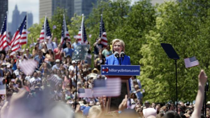 Supporters react as Democratic presidential candidate, former Secretary of State Hillary Rodham Clinton speaks Saturday, June 13, 2015, on Roosevelt Island in New York, in a speech promoted as her formal presidential campaign debut.   (AP Photo/Frank Franklin II)