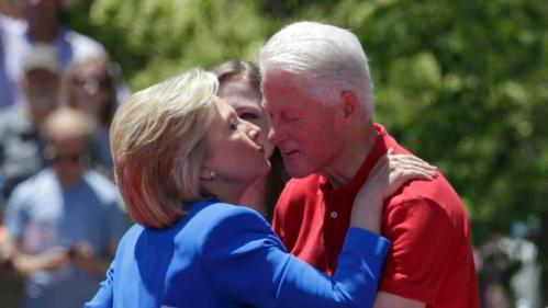 "U.S. Democratic presidential candidate Hillary Clinton kisses her husband former President Bill Clinton (R)  after she delivered her ""official launch speech"" at a campaign kick off rally in Franklin D. Roosevelt Four Freedoms Park on Roosevelt Island in New York City, June 13, 2015.  REUTERS/Brendan McDermid"