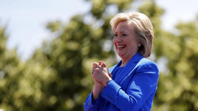 Democratic presidential candidate, former Secretary of State Hillary Rodham Clinton smiles as she arrives to speak to supporters Saturday, June 13, 2015, on Roosevelt Island in New York. (AP Photo/Julio Cortez)