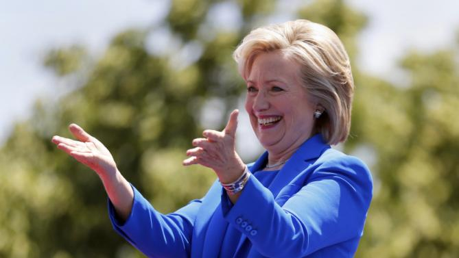 Democratic presidential candidate, former Secretary of State Hillary Rodham Clinton gestures to supporters as she arrives to speak Saturday, June 13, 2015, on Roosevelt Island in New York. (AP Photo/Julio Cortez)