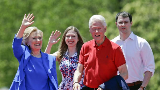Democratic presidential candidate former Secretary of State Hillary Rodham Clinton waves to supporters as her husband former President Bill Clinton, second from right, Chelsea Clinton, second from left, and her husband Marc Mezvinsky, join on stage Saturday, June 13, 2015, on Roosevelt Island in New York.  (AP Photo/Frank Franklin II)