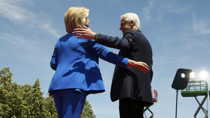"U.S. Democratic presidential candidate Hillary Clinton is joined onstage by her husband former President Bill Clinton after delivering her ""official launch speech"" at a campaign kick off rally in Franklin D. Roosevelt Four Freedoms Park on Roosevelt Island in New York City, June 13, 2015. REUTERS/Lucas Jackson"