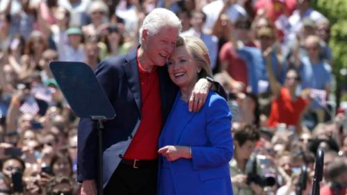 "U.S. Democratic presidential candidate Hillary Clinton is embraced by her husband former President Bill Clinton (L)  after she delivered her ""official launch speech"" at a campaign kick off rally in Franklin D. Roosevelt Four Freedoms Park on Roosevelt Island in New York City, June 13, 2015.  REUTERS/Brendan McDermid"