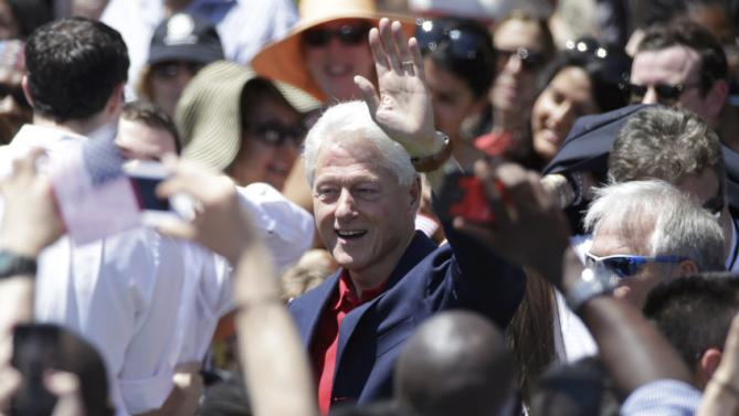 "Former U.S. President Bill Clinton waves as U.S. Democratic presidential candidate Hillary Clinton delivers her ""official launch speech"" at a campaign kick off rally in Franklin D. Roosevelt Four Freedoms Park on Roosevelt Island in New York City, June 13, 2015.  REUTERS/Brendan McDermid"