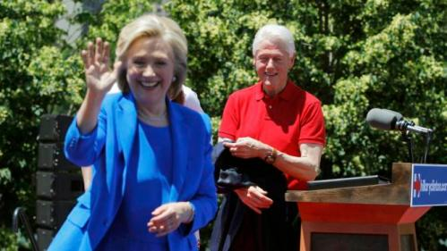 "U.S. Democratic presidential candidate Hillary Clinton is joined onstage by her husband former President Bill Clinton after she delivered her ""official launch speech"" at a campaign kick off rally in Franklin D. Roosevelt Four Freedoms Park on Roosevelt Island in New York City, June 13, 2015. REUTERS/Carlo Allegri"