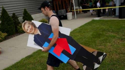 John West carries a life-sized cutout of U.S. Democratic presidential candidate Hillary Clinton at a campaign event in Des Moines, Iowa, United States, June 14, 2015. REUTERS/Jim Young