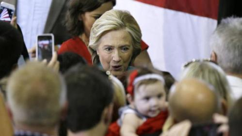 Democratic presidential candidate Hillary Rodham Clinton greets supporters following a rally, Sunday, June 14, 2015, in Des Moines, Iowa. Clinton's campaign has signaled Iowa will be the centerpiece of its ground game. (AP Photo/Charlie Neibergall)