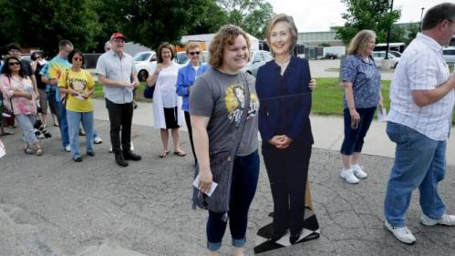 Caitlin Wilson, of Altoona, Iowa, poses with a cardboard cutout of Democratic presidential candidate Hillary Rodham Clinton outside a rally, Sunday, June 14, 2015, in Des Moines, Iowa. Seeking an army of volunteers, Clinton is trying to build an organizational edge in Iowa as some of her lesser-known Democratic rivals clamor for attention in the state that tripped up her first presidential campaign. (AP Photo/Charlie Neibergall)