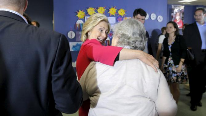 Democratic presidential candidate Hillary Clinton greets audience members after speaking at a campaign stop at the YMCA in Rochester, New Hampshire June 15, 2015.  REUTERS/Brian Snyde
