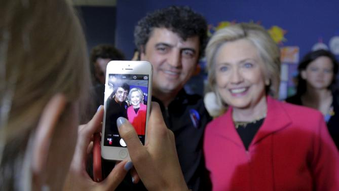 Democratic presidential candidate Hillary Clinton poses for a photograph with an audience members after speaking at a campaign stop at the YMCA in Rochester, New Hampshire June 15, 2015.  REUTERS/Brian Snyde
