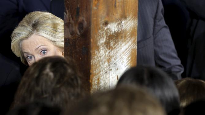 Democratic presidential candidate Hillary Clinton looks around a post to greet audience members at a campaign launch party at Carter Hill Orchard in Concord, New Hampshire June 15, 2015.  REUTERS/Brian Snyder      TPX IMAGES OF THE DAY
