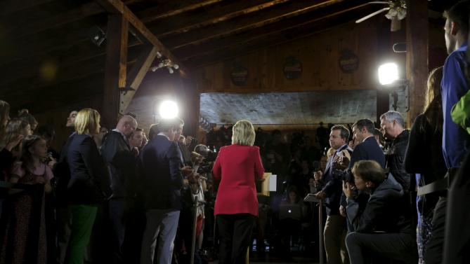Democratic presidential candidate Hillary Clinton answers questions from reporters following a campaign launch party at Carter Hill Orchard in Concord, New Hampshire June 15, 2015.  REUTERS/Brian Snyder