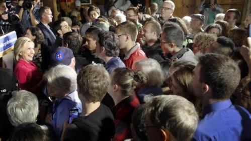 Democratic presidential candidate Hillary Rodham Clinton, left, is greeted by people that packed into a barn as rain fell, Monday, June 15, 2015, in Concord, N.H. (AP Photo/Jim Cole)