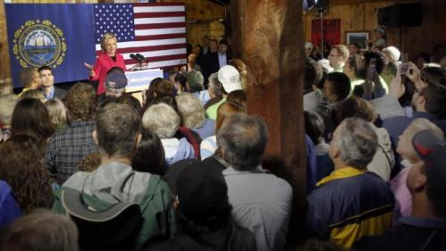 People packed into a barn to see and hear Democratic presidential candidate Hillary Rodham Clinton as rain fell, Monday, June 15, 2015, in Concord, N.H. (AP Photo/Jim Cole)