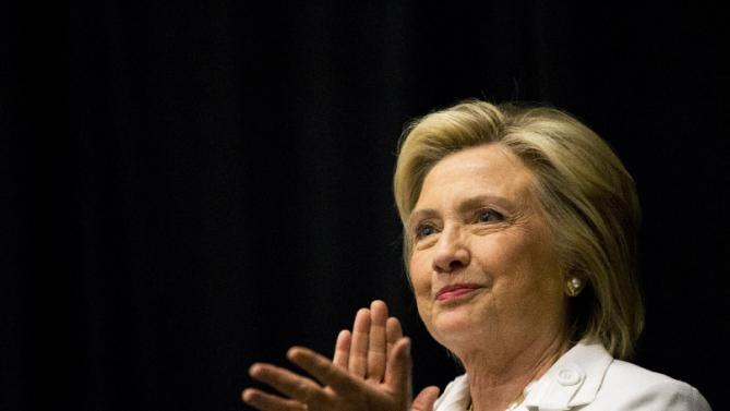 Democratic presidential candidate Hillary Rodham Clinton listens to a speaker during a campaign stop, Wednesday, June 17, 2015, in Santee, S.C. (AP Photo/David Goldman)