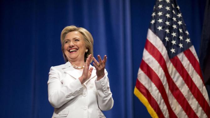 Democratic presidential candidate Hillary Rodham Clinton steps onstage to address an audience at Trident Technical College during a campaign stop Wednesday, June 17, 2015, in North Charleston, S.C. (AP Photo/David Goldman)