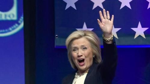 Democratic presidential candidate Hillary Rodham Clinton waves as she arrives to speak at the National Association of Latino Elected and Appointed Officials conference, Thursday, June 18, 2015, in Las Vegas. (AP Photo/David Becker)