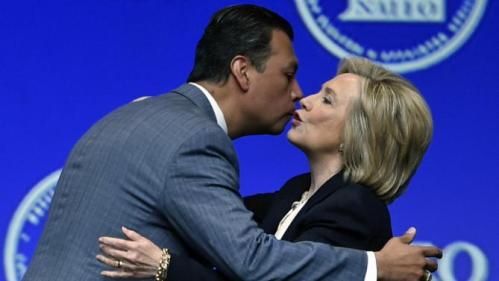 Democratic presidential candidate Hillary Rodham Clinton is greeted by California Secretary of State Alex Padilla, president of  National Association of Latino Elected and Appointed Officials, before she spoke at NALEO, Thursday, June 18, 2015, in Las Vegas. (AP Photo/David Becker)