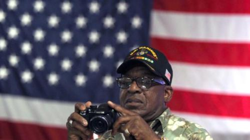 George Davis, a Vietnam War veteran from North Carolina, photographs the audience prior to Democratic presidential candidate Hillary Rodham Clinton's arrival and roundtable discussion in Reno, Nev., Thursday, June 18, 2015. Clinton said her top priorities as president would include taking care of veterans when they return home. (AP Photo/Lance Iversen)