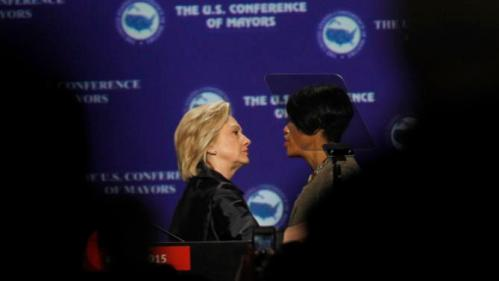 Democratic presidential candidate Hillary Rodham Clinton talks with Baltimore MayorStephanie Rawlings-Blake at the U.S. Conference of Mayors 83rd Annual Meeting in San Francisco, Saturday, June 20, 2015. (AP Photo/Mathew Sumner)