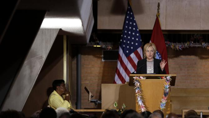 Democratic presidential candidate Hillary Rodham Clinton speaks as Pastor Traci Blackmon, left, listens, during a campaign stop at Christ the King United Church of Christ, Tuesday, June 23, 2015, in Florissant, Mo. (AP Photo/Jeff Roberson)