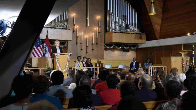 Democratic presidential candidate and former Secretary of State Hillary Clinton speaks about the shooting in Charleston, South Carolina and the controversy over the Confederate flag during a community meeting at Christ the King United Church of Christ while campaigning for president in Florissant, Missouri June 23, 2015.  REUTERS/Kate Munsch