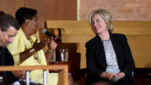 Pastor Traci Blackmon (L) talks with  Democratic presidential candidate and former Secretary of State Hillary Clinton during a community meeting at Christ the King United Church of Christ in Florissant, Missouri June 23, 2015. REUTERS/Kate Munsch