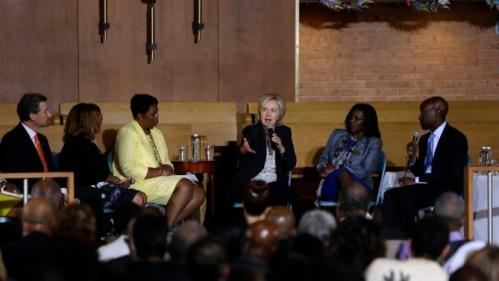 Democratic presidential candidate Hillary Rodham Clinton participates in a panel discussion during a campaign stop at Christ the King United Church of Christ, Tuesday, June 23, 2015, in Florissant, Mo. (AP Photo/Jeff Roberson)