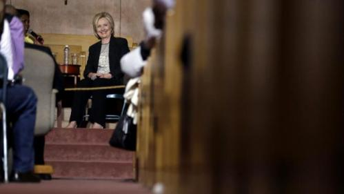 Democratic presidential candidate Hillary Rodham Clinton takes part in a panel discussion during a campaign stop at Christ the King United Church of Christ, Tuesday, June 23, 2015, in Florissant, Mo. Clinton joined with church members in the St. Louis suburbs, near the violent protests touched off last year in nearby Ferguson after the death of Michael Brown, an unarmed young black man who was shot by a white police officer. (AP Photo/Jeff Roberson)