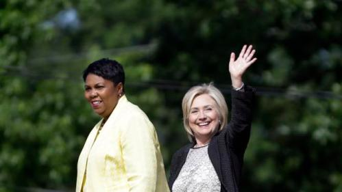 Democratic presidential candidate Hillary Rodham Clinton waves as she walks out of Christ the King United Church of Christ alongside Pastor Traci Blackmon, left, at the end of a campaign stop, Tuesday, June 23, 2015, in Florissant, Mo. (AP Photo/Jeff Roberson)