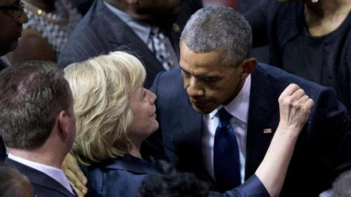 President Barack Obama embraces Democratic presidential candidate, former Secretary of State Hillary Rodham Clinton as he leaves services honoring the life of Rev. Clementa Pinckney, Friday, June 26, 2015, at the College of Charleston TD Arena in Charleston, S.C. Pinckney was one of the nine people killed in the shooting at Emanuel AME Church last week in Charleston. (AP Photo/Carolyn Kaster)